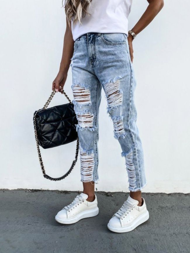 Straight hole ripped raw edge nine-point jeans